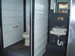 restrooms in a shipping container, shipping container modification with restrooms and showers