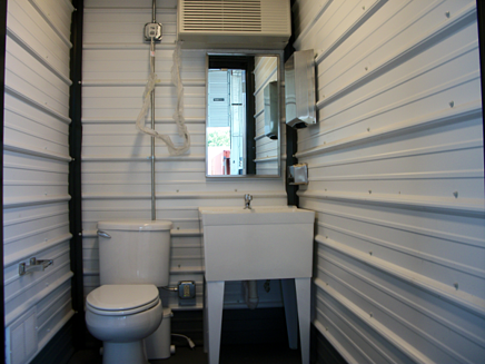 20' Running water restroom container, containerized running water restroom, shipping container modification, custom shipping container modification, mil van container modification