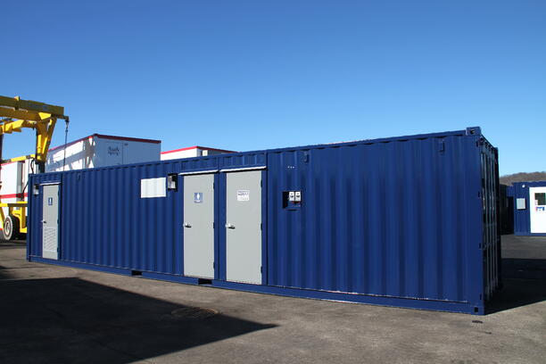 DropBox Inc, running water restroom, containerized restroom, containerized restroom trailer, portable restroom trailer, modular running water restroom, portable restrooms