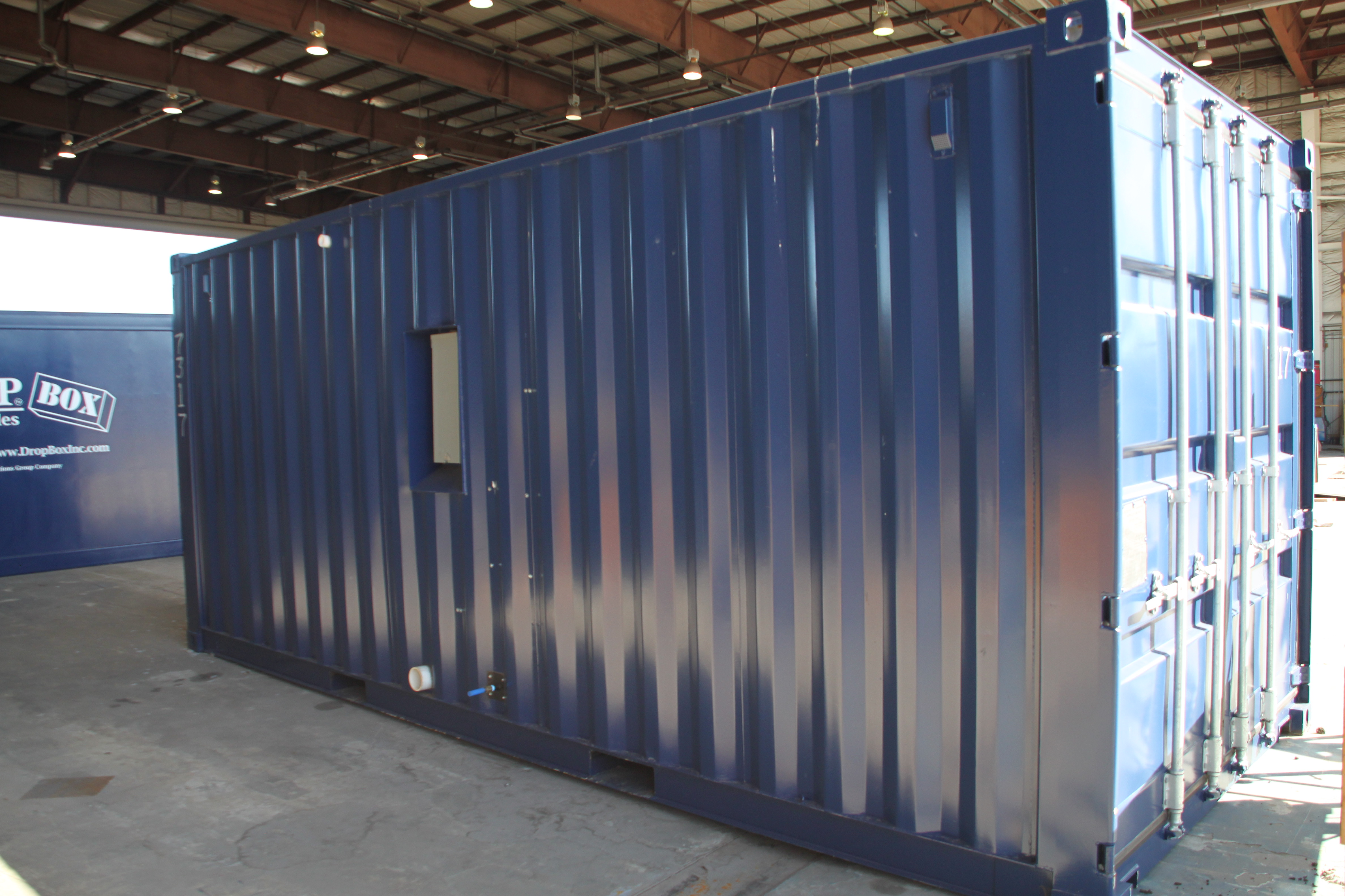 DropBox Inc, containerized restroom, containerized shower trailer, containerized shower unit, portable septic system, containerized septic system, containerized sewer holding tanks